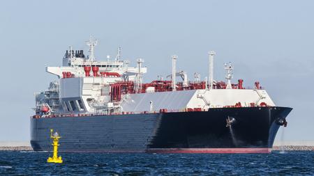 LNG TANKER - The big ship maneuvers to gas terminal Stock Photo