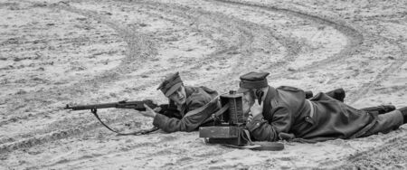 KOLOBRZEG, WEST POMERANIAN / POLAND - 2019: Reconstruction of battle for Kolobrzeg - Field telephone operator and shooter of the Polish Army Imagens - 128078637