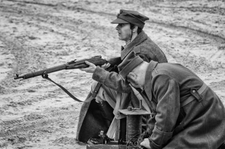 KOLOBRZEG, WEST POMERANIAN / POLAND - 2019: Reconstruction of battle for Kolobrzeg - Field telephone operator and shooter of the Polish Army