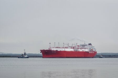 SWINOUJSCIE, WEST POMERANIAN / POLAND - 2019: The great LNG tanker IBERICA KNUTSEN with gas terminal in the port Editorial