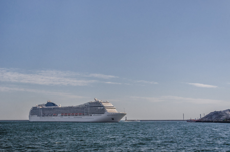 CRUISE SHIP - A beautiful passenger ship maneuvers in the port of Gdynia