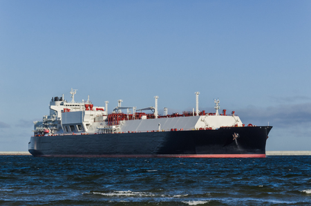 LNG TANKER - A ship with a gas load goes to the port
