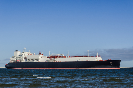 GAS CARRIER - A tanker with a natural gas cargo flows into the sea port