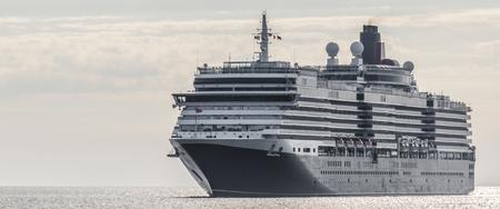 CRUISE SHIP - A majestic British passenger ship is sailing on the sea