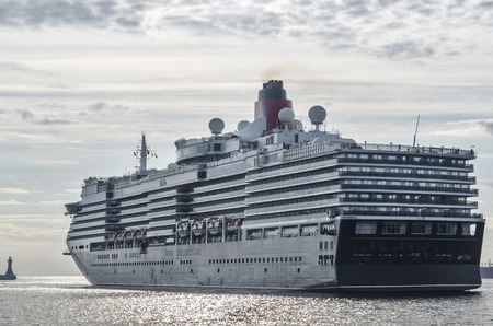 CRUISE SHIP - A majestic passenger ship is maneuvered at the port wharf