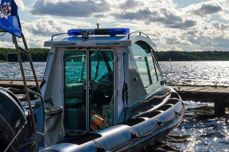 SZCZECINEK, WEST POMERANIAN / POLAND - 2019: A police boat prepared for activities on the lake Redakční