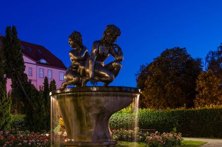 SZCZECINEK, WEST POMERANIAN / POLAND - 2019: Water nymphs and a romantic warm evening in the city park among sleepeng roses