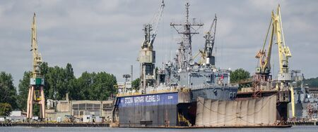 GDYNIA, POMERANIA REGION  POLAND - 2019: Warship of the Polish Navy frigate ORP KOSCIUSZKO in the dock repair of Naval Shipyard Editorial