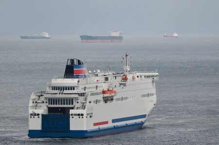 SEASCAPE - Passenger ferry and merchant ships in the roadstead