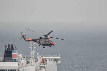 GDYNIA, POMERANIA REGION  POLAND - 2019: A sea search and rescue helicopter of the Polish Coast Guard in action by the sea