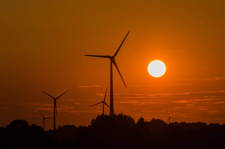 WIND FARM - Hot evening landscape over the fields