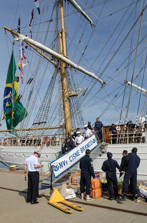 GDYNIA, POMERANIAN REGION  POLAND - 2019: Supply of crew food to the Brazilian sailing vessel CISNE BRANCO