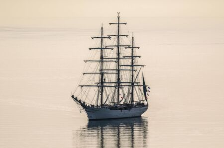 SAILING VESSEL - A beautiful frigate in the calm morning waters of the sea