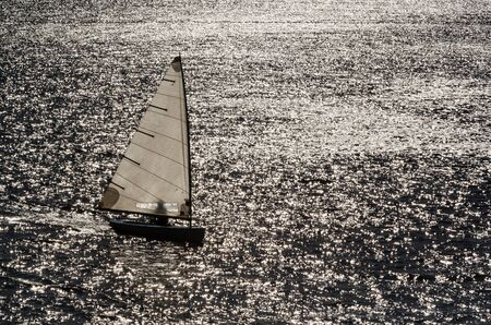 REGATTA IN SUNNY RAYS - Sailboat on the waves of the lake Reklamní fotografie