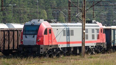 RAILWAY TRANSPORT - A modern locomotive pulls freight wagons Stock fotó - 130738408