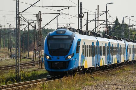 ELECTRIC MULTIPLE UNIT - Modern passenger train on the railway route