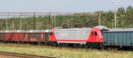 RAILWAY TRANSPORT - A modern locomotive pulls freight wagons Stock fotó - 130738410