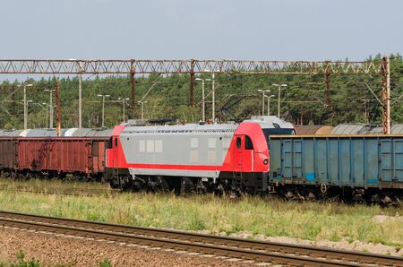 RAILWAY TRANSPORT - A modern locomotive pulls freight wagons Stock fotó
