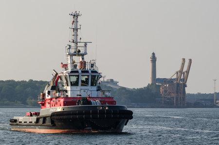 SWINOUJSCIE, WEST POMERANIAN  POLAND - 2019: Fireboat sails on the background of sea port Sajtókép