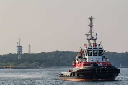 FIREBOAT - Red ship on the background of the sea port Stock fotó - 130738557