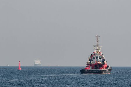 FIREBOAT AND LNG TANKER - Ships on the sea flow towards each other