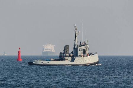 TUGBOAT AND TANKER - Warship and large gas tanker on the waterway