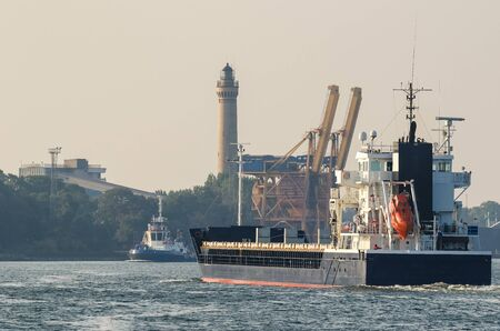 GENERAL CARGO SHIP - Freighter is sailing to the port