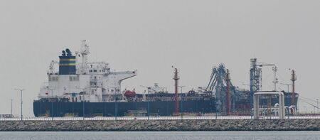 OIL TERMINAL - Big tanker and seaport fuel waterfront infrastructure Stock fotó