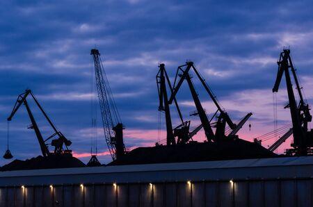 TRANSSHIPMENT TERMINAL - Port cranes on the coal quay in Gdynia at sunrise Stock fotó - 131472437