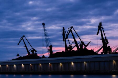 TRANSSHIPMENT TERMINAL - Port cranes on the coal quay in Gdynia at sunrise Stock fotó - 131470828