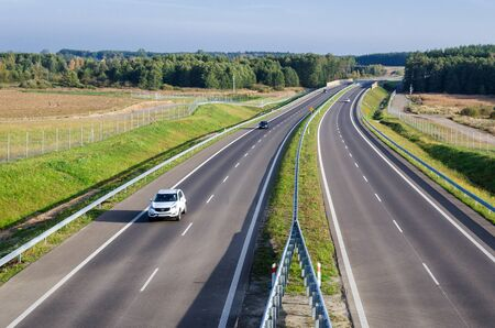 KOLOBRZEG, WEST POMERANIAN  POLAND - 2019: Car traffic on a modern international express road Sajtókép