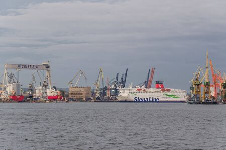 GDYNIA, POMERANIAN REGION  POLAND - 2019: A passenger ferry maneuvers in the seaport basin