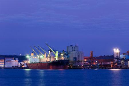 GDYNIA, POMERANIAN REGION  POLAND - 2019; Illuminated ship at the grain terminal