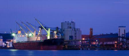 EVENING HARBOR LIFE - Illuminated ship at the grain terminal in Gdynia