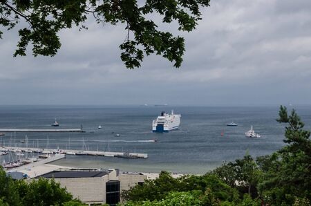PASSENGER FERRY AT THE SEA SHORE - Ships and boats on the bay Stock fotó