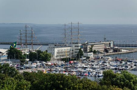 GDYNIA, POMERANIAN REGION  POLAND - 2019: The Brazilian sailing vessel CISNE BRANCO and the Polish frigate DAR M?ODZIEZY moored at the quays of the seaport