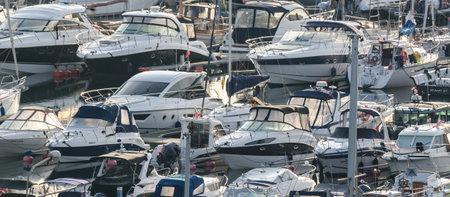 GDYNIA, POMERANIAN REGION  POLAND - 2019: Motor boats moored to the marina quays Sajtókép