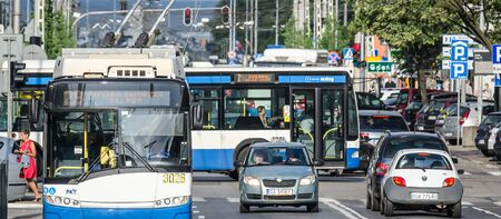 GDYNIA, POMERANIAN REGION  POLAND - 2019: Public transport vehicles and cars on the street in the city center 報道画像