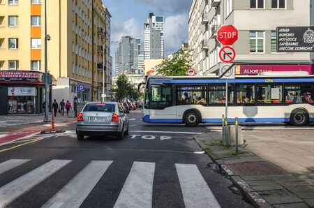 GDYNIA, POMERANIAN REGION  POLAND - 2019: City bus, cars and people on the street on a sunny day