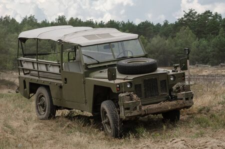 OFF-ROAD CAR - Military vehicle in the field 写真素材