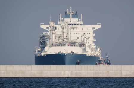 LNG TANKER AND BREAKWATER - Great ship sail to the gas terminal in Swinoujscie 写真素材