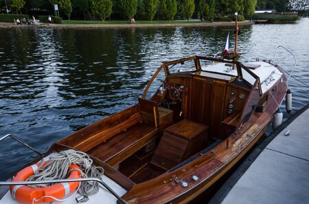 A BEAUTIFUL BOAT ON THE LAKE - Classic wooden motorboat at the walking pier