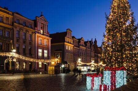 POZNAN  POLAND - 2019: A Christmas tree glittering with colorful lights and a Christmas market on the Town Hall Square