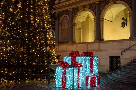POZNAN  POLAND - 2019: CHRISTMAS TIME - Shiny presents and a Christmas tree on the town hall square