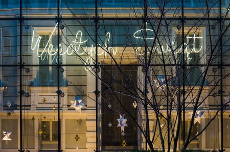 POZNAN  POLAND - 2019: Neon Merry Christmas on the wall of the STARY BROWAR shopping gallery