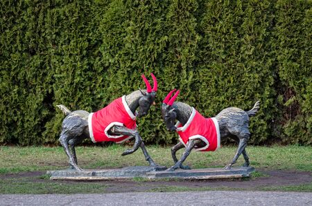POZNAN  POLAND - 2019: Symbol of the city - figurines of Poznan goats in the park dressed in Christmas costumes Editöryel