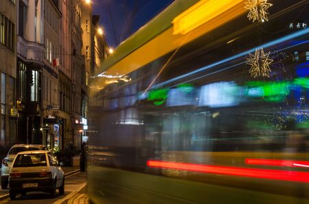 POZNAN  POLAND - 2019: Tram on a street decorated with Christmas lights