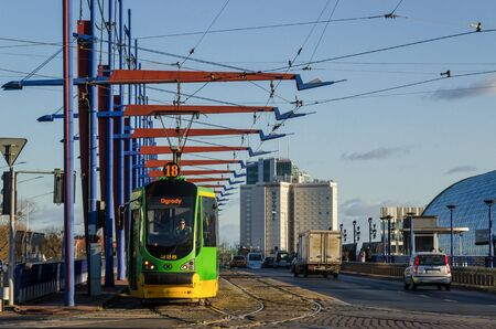 POZNAN  POLAND - 2019: Tram on the viaduct in front of the modern train station
