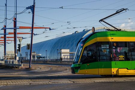 POZNAN  POLAND - 2019: Tram on the background of the building of a modern railway station Editöryel