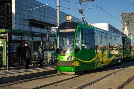 POZNAN  POLAND - 2019: Tram and passengers at a city center stop Editöryel